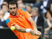 Marin Cilic of Croatia hits a backhand against Tomas Berdych of Czech Republic during their final match the ABN AMRO tennis tournament in Rotterdam February 16, 2014. REUTERS/Paul Vreeker/United Photos