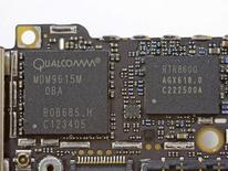 Handout image released by iFixit.com shows the Qualcomm MDM9615M chip on a board of a new iPhone 5 in Melbourne, Australia September 21, 2012. REUTERS/iFixIt.com/Handout