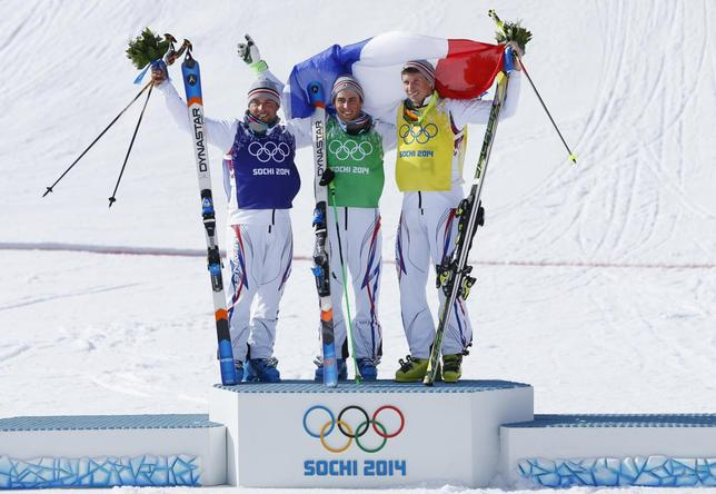 From L-R: Second-placed France's Arnaud Bovolenta poses with compatriots winner Jean Frederic Chapuis and third-placed Jonathan Midol on the podium after their men's freestyle skiing skicross finals round at the 2014 Sochi Winter Olympic Games in Rosa Khutor February 20, 2014. REUTERS/Mike Blake