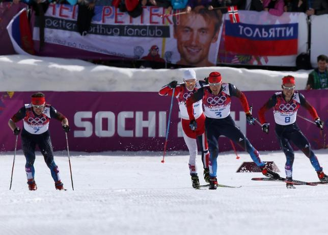 Russia's Alexander Legkov (2nd R) Maxim Vylegzhanin (L) and Ilia Chernousov (R) race to the finish line to take first, second and third place, ahead of Norway's Martin Johnsrud Sundby in the men's cross-country 50 km mass start free event at the Sochi 2014 Winter Olympic Games February 23, 2014. REUTERS/Sergei Karpukhin