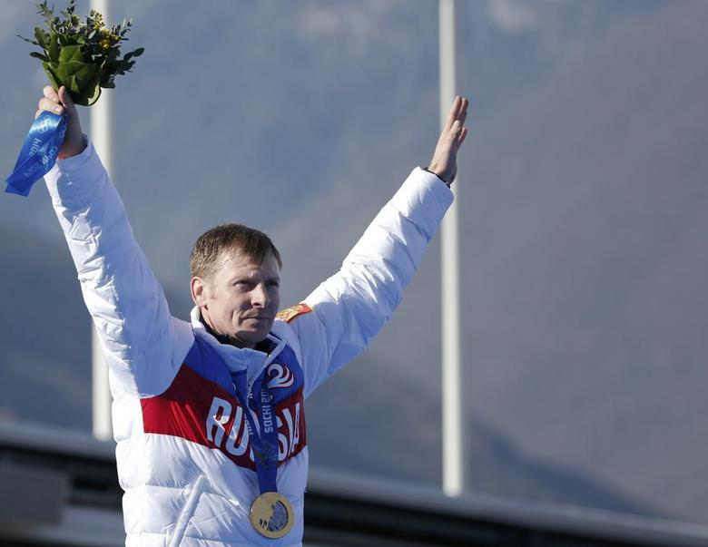 Russia's pilot Alexander Zubkov poses with a gold medal during a ceremony for the four-man bobsleigh event at the Sochi 2014 Winter Olympics, at the Sanki Sliding Center in Rosa Khutor February 23, 2014. REUTERS/Murad Sezer