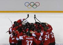 Canada's players huddle as they celebrate defeating Sweden in their men's ice hockey gold medal game at the Sochi 2014 Winter Olympic Games February 23, 2014. REUTERS/Mark Blinch
