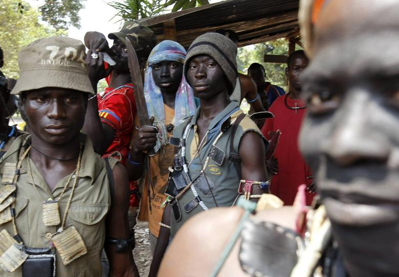 Fighters from the Christian ''anti-balaka'' militia stand at the headquarters in the northern Bangui suburb of Boeing, an area near the Mpoko International Airport of Bangui February 22, 2014. REUTERS/Luc Gnago