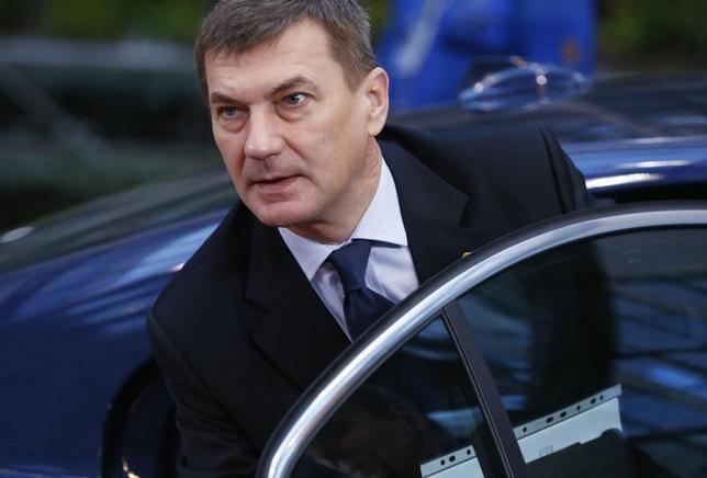 Estonia's Prime Minister Andrus Ansip arrives at a European Union leaders summit at the EU council headquarters in Brussels December 20, 2013. REUTERS/Yves Herman