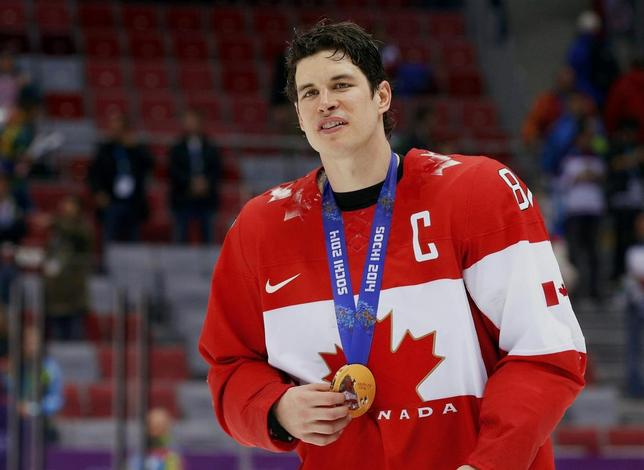 Canada's Sidney Crosby holds his gold medal at the victory ceremony for the men's ice hockey competition at the Sochi 2014 Winter Olympic Games February 23, 2014. REUTERS/Brian Snyder