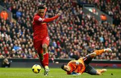 Liverpool's Daniel Sturridge (L) scores past Swansea's Michel Vorm during their English Premier League soccer match at Anfield in Liverpool, northern England, February 23, 2014. REUTERS/Darren Staples