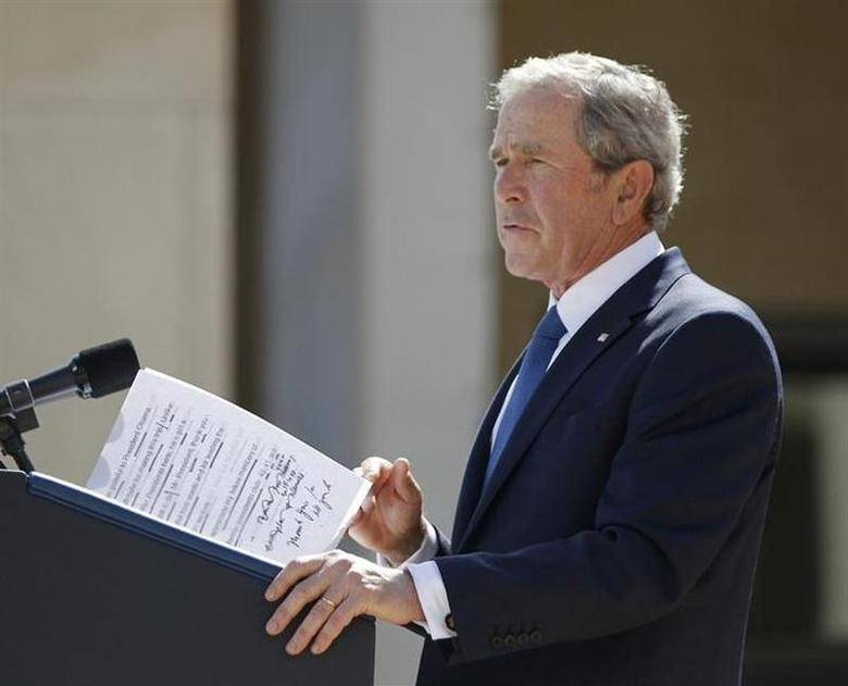 Former U.S. President George W. Bush delivers remarks with some hand-written notes during the dedication ceremony of the George W. Bush Presidential Center in Dallas, April 25, 2013. REUTERS/Jason Reed