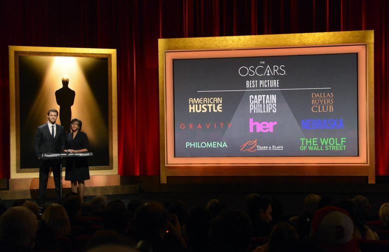 Actor Chris Hemsworth (L) and Academy of Motion Picture Arts and Sciences President Cheryl Boone Isaacs announce the nominees for Best Picture at the 86th Academy Awards nominee announcements in Beverly Hills, California on January 16, 2014. REUTERS/Phil McCarten