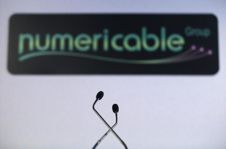 A logo of French cable operator Numericable is seen behind microphones during a news conference in Paris, October 28, 2013. REUTERS/Christian Hartmann