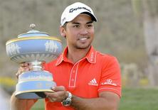 Feb 23, 2014; Marana, AZ, USA; Jason Day poses with the Walter Hagen Trophy after winning the final round of the World Golf Championships - Accenture Match Play Championship at The Golf Club at Dove Mountain. Casey Sapio-USA TODAY Sports
