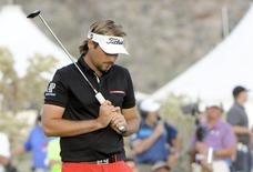 Feb 23, 2014; Marana, AZ, USA; Victor Dubuisson reacts after his putt on the 21st hole after winning the final round of the World Golf Championships - Accenture Match Play Championship at The Golf Club at Dove Mountain. Mandatory Credit: Casey Sapio-USA TODAY Sports