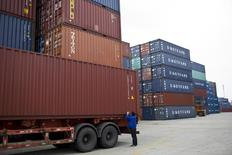 An employee takes notes at a port of Shanghai Free Trade Zone, February 11, 2014. REUTERS/Aly Song