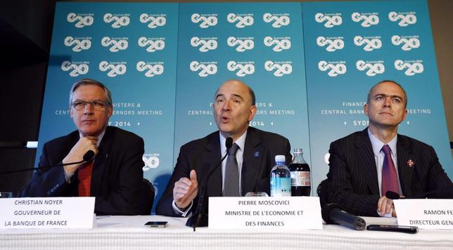 French Economic Minister Pierre Moscovici (C) speaks alongside France's Central Bank Governor Christian Noyer and General Director of Treasury Ramon Fernandez at the G20 Central Bank Governors and Finance Ministers annual meeting in Sydney, February 23, 2014. REUTERS/Jason Reed