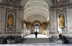 A woman walks in an empty hall at the Royal Museum for Central Africa in Tervuren, near Brussels, January 22, 2014. REUTERS/Francois Lenoir