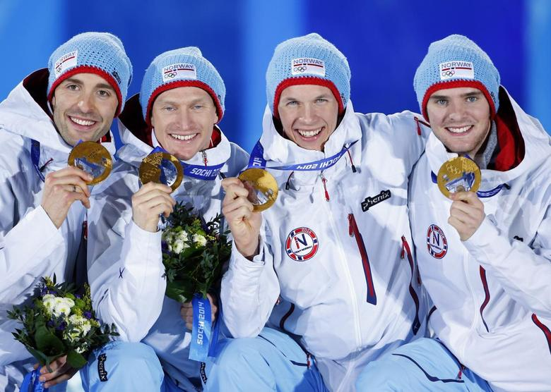 Gold medallists Norway's Magnus Hovdal Moan, Haavard Klemetsen, Magnus Krog and Joergen Graabak (L-R) celebrate during the victory ceremony for the Nordic combined team Gundersen large hill event at the Sochi 2014 Winter Olympic Games February 20, 2014. REUTERS/Shamil Zhumatov