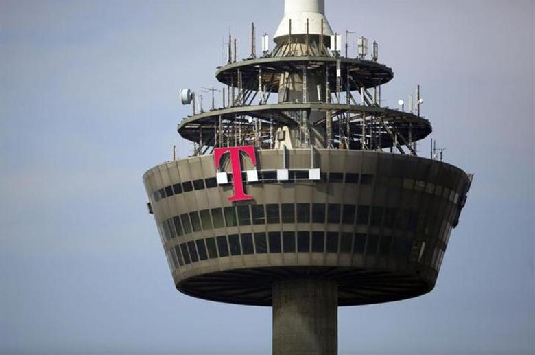 The logo of Deutsche Telekom is pictured on the 266 metre high ''Colonia'' TV tower in the western German city of Cologne March 25, 2013. REUTERS/Wolfgang Rattay/Files