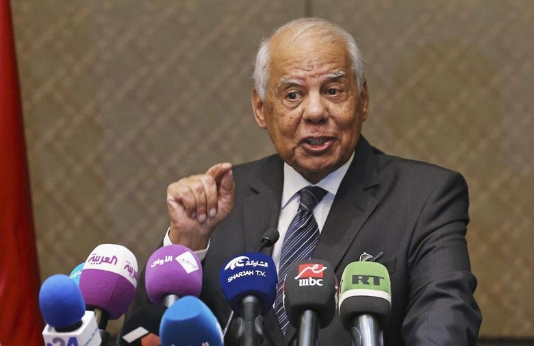 Egypt's Prime Minister Hazem el-Beblawi gestures during a news conference in Abu Dhabi October 27, 2013. REUTERS/Ben Job
