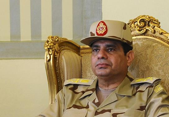 Egypt's Defense Minister Abdel Fattah al-Sisi is seen during a news conference in Cairo, in this May 22, 2013 file picture. REUTERS-Stringer-Files