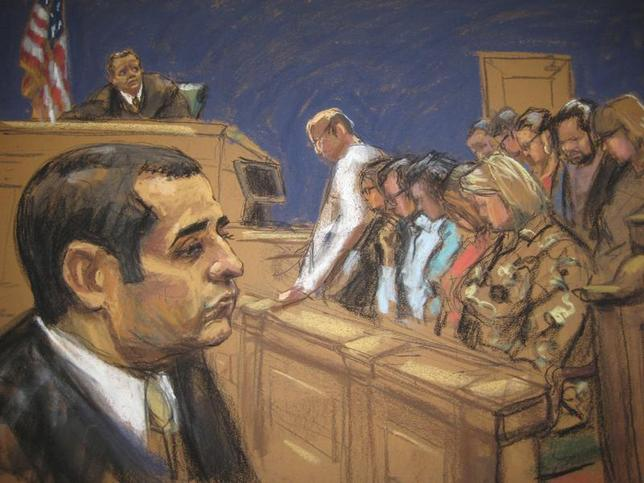 Former New York City police officer Gilberto Valle, dubbed by local media as the ''Cannibal Cop'' after a verdict was delivered at his trial as seen in this courtroom sketch in New York March 12, 2013. REUTERS/Jane Rosenberg