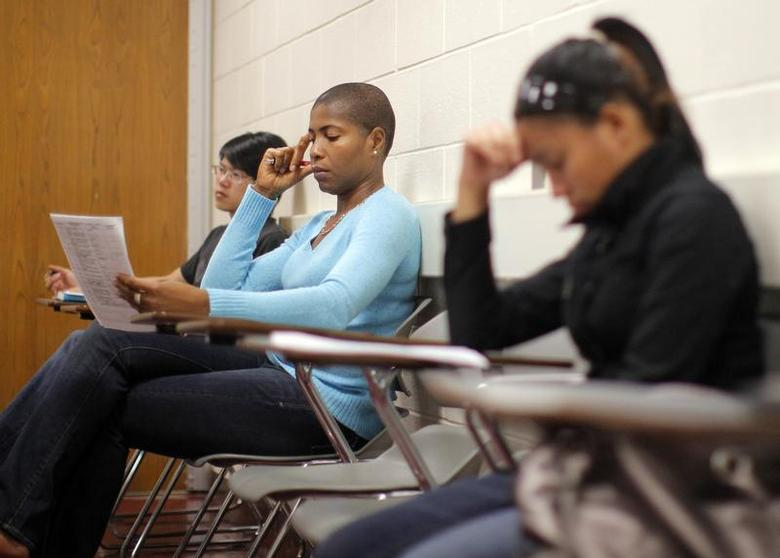 Students listen to professor Christian Agunwamba during their ''Fundamentals of Algebra'' class at Bunker Hill Community College in Boston, Massachusetts September 9, 2010. REUTERS/Brian Snyder