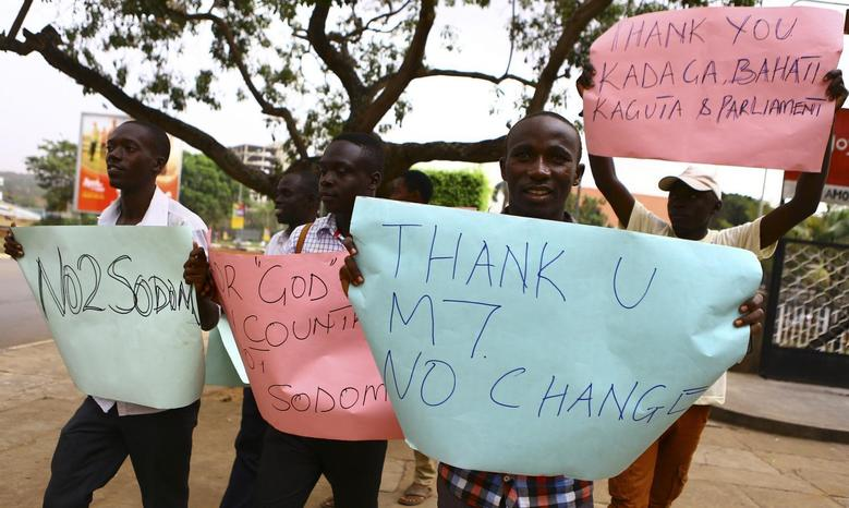Anti-gay supporters celebrate after Uganda's President Yoweri Museveni signed a law imposing harsh penalties for homosexuality in Kampala February 24, 2014. REUTERS/Edward Echwalu