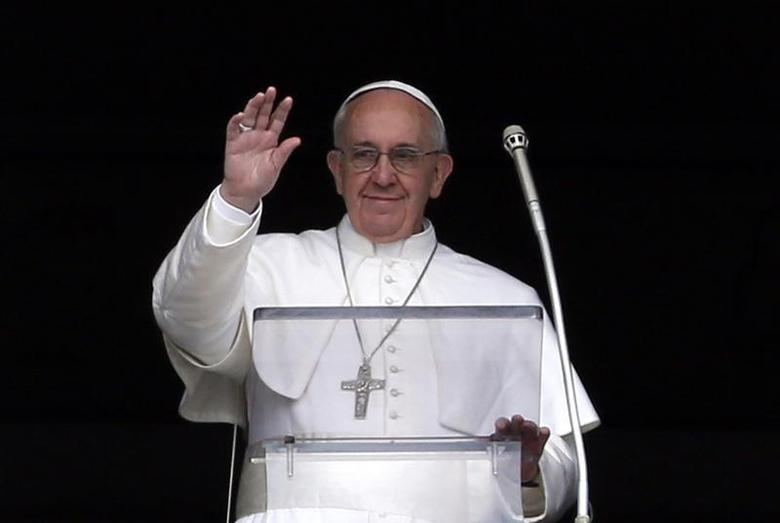 Pope Francis waves to the faithful as he appears at the window of his future private apartment in St. Peter's Square, during the Angelus prayer at the Vatican April 1, 2013. REUTERS/Stefano Rellandini