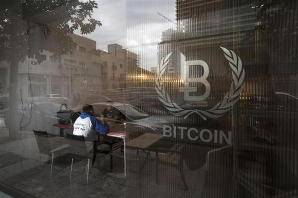 People sit inside the Bitcoin Embassy in Tel Aviv February 2, 2014. REUTERS/Baz Ratner
