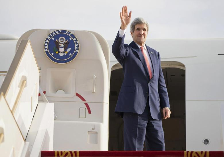 U.S. Secretary of State John Kerry waves as he departs Abu Dhabi International Airport February 18, 2014. REUTERS/Evan Vucci/Pool