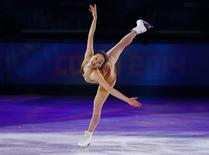 Japan's Mao Asada performs during the Figure Skating Gala Exhibition at the Sochi 2014 Winter Olympics, February 22, 2014. REUTERS/Lucy Nicholson