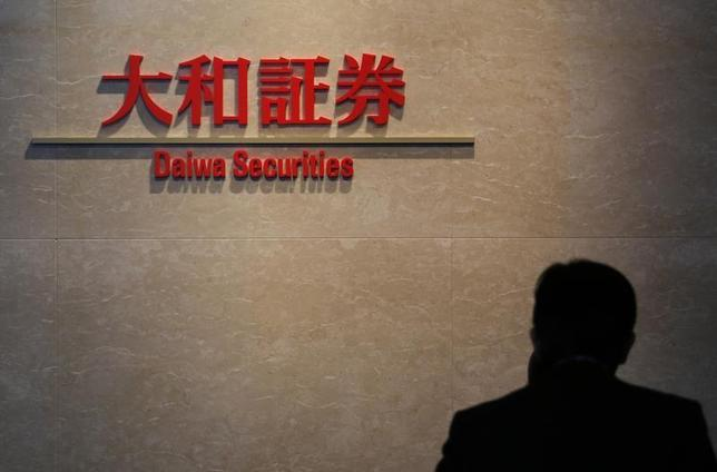 A logo of Daiwa Securities is pictured at the company's lobby in Tokyo December 21, 2012. REUTERS/Yuriko Nakao