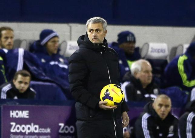 Chelsea manager Jose Mourinho holds the ball during the team's English Premier League soccer match against West Bromwich Albion at the Hawthorns in West Bromwich, central England, February 11, 2014. REUTERS/Darren Staples
