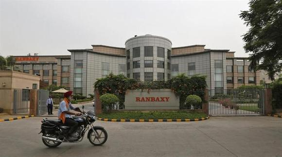 A man rides a motorcycle in front of the office of Ranbaxy Laboratories at Gurgaon, on the outskirts of New Delhi, June 13, 2013. REUTERS/Adnan Abidi/Files