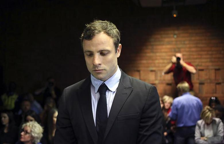 Olympic and Paralympic running star Oscar Pistorius stands during court proceedings at the Pretoria Magistrates court August 19, 2013. REUTERS/Siphiwe Sibeko/Files