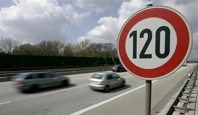 Cars pass a 120 km/h (75 mph) speed limit sign on the A27 Autobahn near the northern German city of Bremen April, 10 2008. REUTERS/Morris Mac Matzen