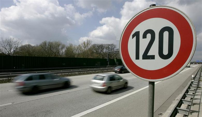 Cars pass a 120 km/h (75 mph) speed limit sign on the A27 Autobahn near the northern German city of Bremen April, 10 2008. REUTERS/Morris Mac Matzen
