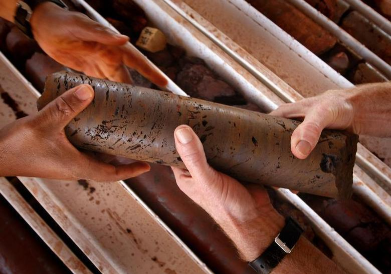 An iron ore core sample is handled at a prospective mine near Port Hedland, Australia, May 26, 2008. REUTERS/Tim Wimborne''
