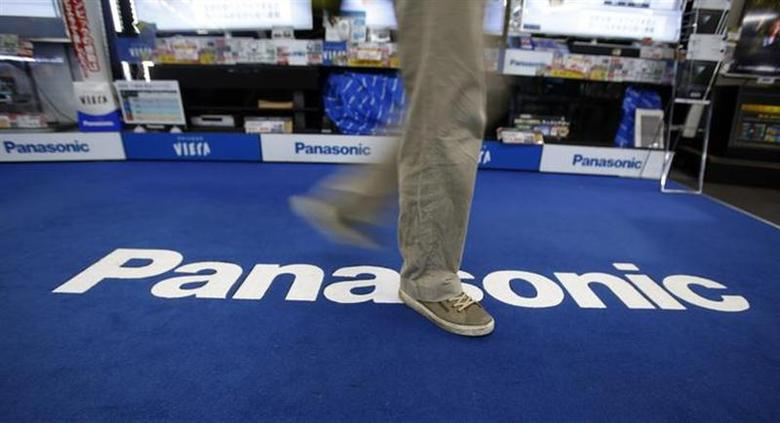A shopper walks past a Panasonic Corp logo at an electronics retail store in Tokyo February 3, 2014. REUTERS/Yuya Shino