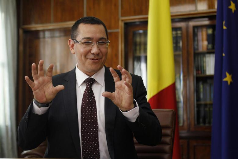 Romania's Prime Minister Victor Ponta gestures during an interview with Reuters in Bucharest September 25, 2013 file photo. REUTERS/Bogdan Cristel
