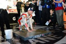 NASCAR Sprint Cup driver Dale Earnhardt Jr (88) inshrines his hands in cement after winning the Daytona 500 at Daytona International Speedway. Mandatory Credit: Jasen Vinlove-USA TODAY Sports