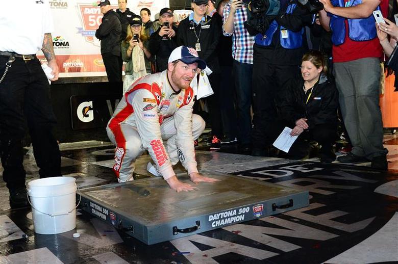 NASCAR Sprint Cup driver Dale Earnhardt Jr (88) inshrines his hands in cement after winning the Daytona 500 at Daytona International Speedway. Mandatory Credit: Jasen Vinlove-USA TODAY Sports