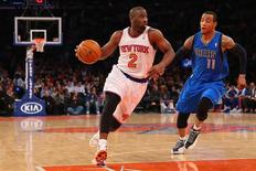 Feb 24, 2014; New York, NY, USA; New York Knicks point guard Raymond Felton (2) dribbles the ball in front of Dallas Mavericks shooting guard Monta Ellis (11) during the third quarter at Madison Square Garden. Dallas Mavericks won 110-108. Mandatory Credit: Anthony Gruppuso-USA TODAY Sports - RTR3FP2K