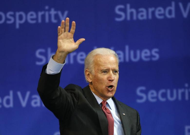 U.S. Vice President Joe Biden waves to the crowd as he leaves after delivering his speech at Yonsei University in Seoul December 6, 2013. REUTERS/Kim Hong-Ji