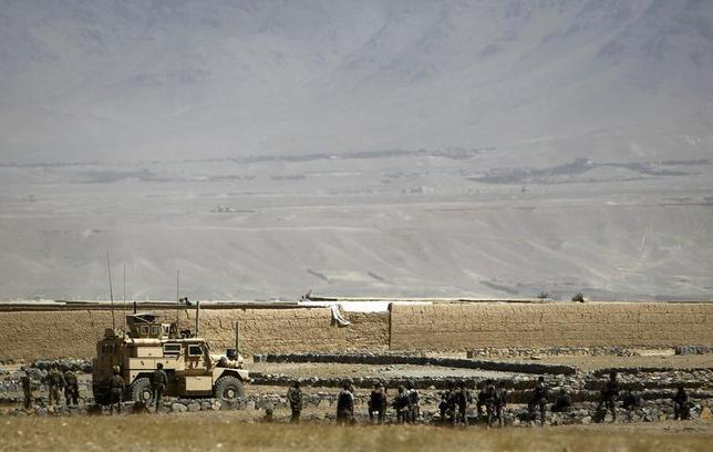 U.S. troops arrive near the site of an incident Kabul August 2, 2012 file photo. REUTERS/Omar Sobhani