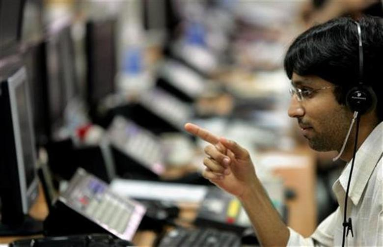 A broker monitors indices during trading hours at a brokerage firm in Mumbai September 8, 2005. REUTERS/Punit Paranjpe/Files