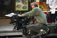 "U.S director and producer Michael Bay holds a camera during the filming of a scene for the movie ""Transformers: Age of Extinction"" in Hong Kong October 24, 2013. REUTERS/Tyrone Siu"