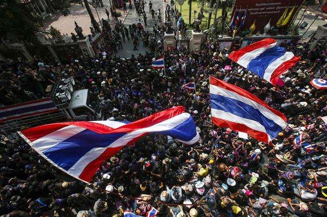 Anti-government protesters gather outside the Royal Thai Police headquarters during a rally in central Bangkok February 26, 2014. REUTERS/Athit Perawongmetha