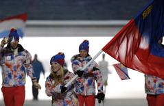 Liechtenstein's flag-bearer Tina Weirather leads her country's contingent during the athletes' parade at the opening ceremony of the 2014 Sochi Winter Olympics, February 7, 2014. REUTERS/Phil Noble
