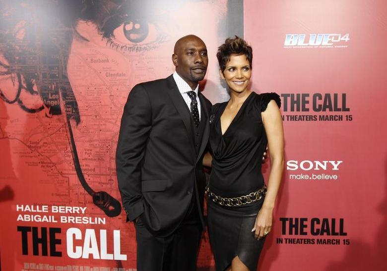 Cast member Halle Berry (R) poses with co-star Morris Chestnut at the premiere of ''The Call'' in Los Angeles, California March 5, 2013. REUTERS/Mario Anzuoni