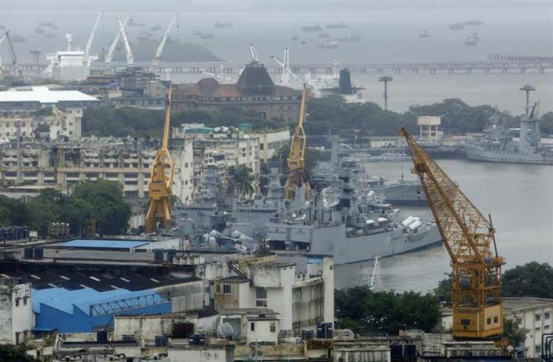 An elevated view shows the Indian Navy ships docked at the naval dockyard in Mumbai August 14, 2013. REUTERS/Vivek Prakash/Files