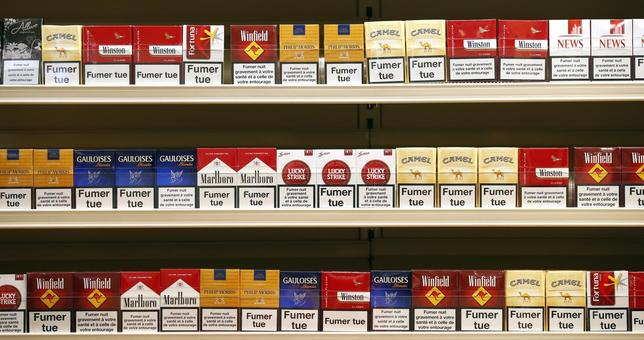 Cigarette packs are presented on shelves in a simulated tobacconist shop at a news conference in Paris October 16, 2013. REUTERS/Benoit Tessier